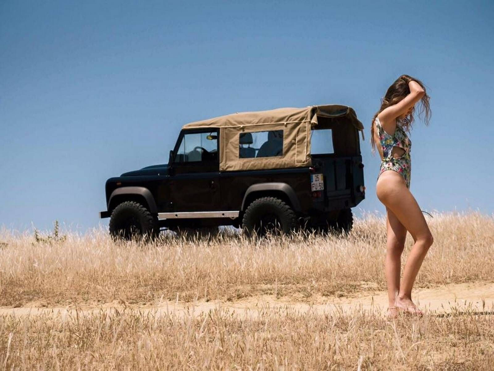 Cars and girls hot model and a land rover defender at the beach