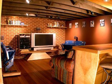 Sports Themed Man Cave eclectic basement #mancavegarage