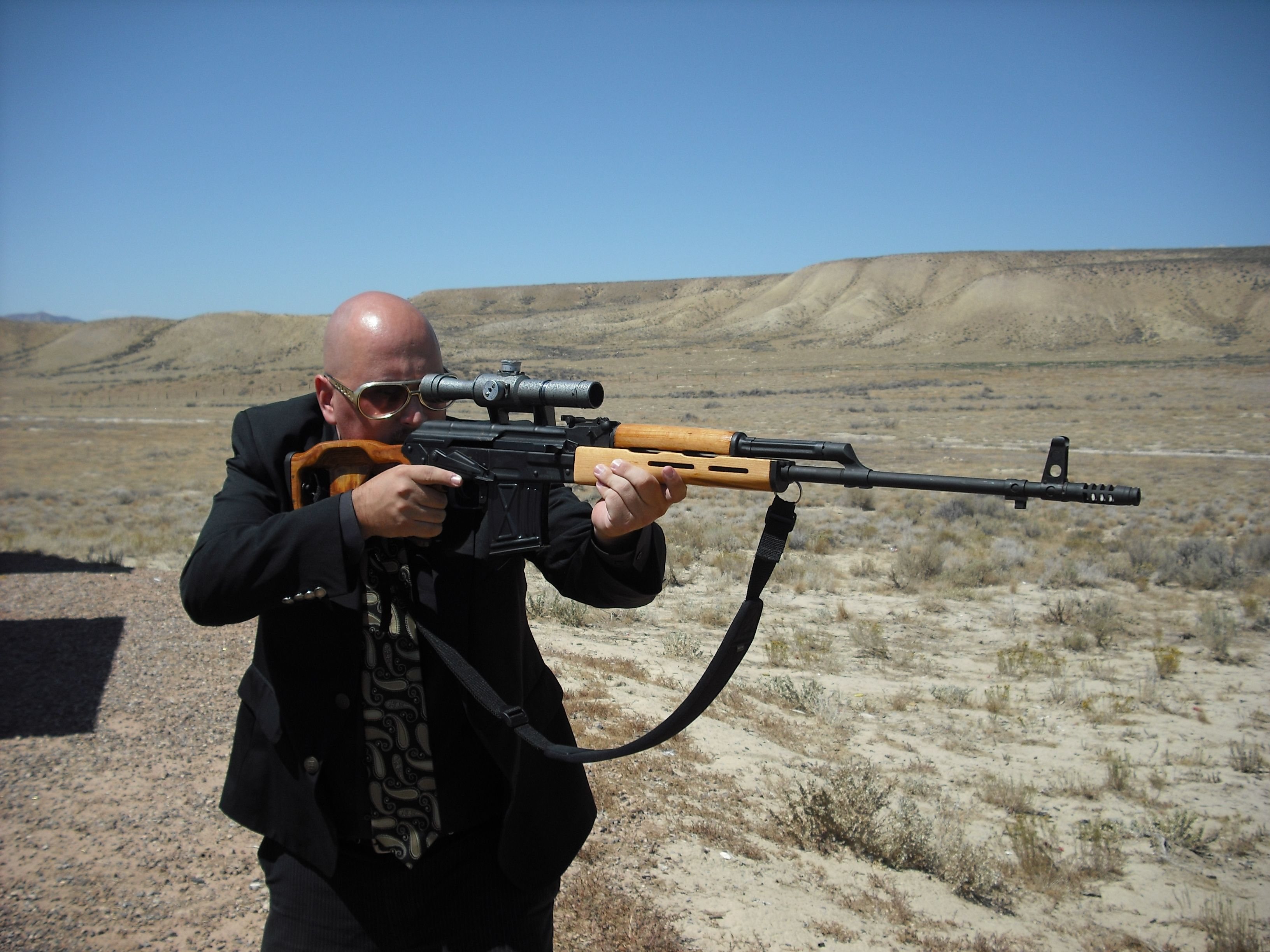 Me with one of my favorite guns, the Romanian PSL  It's kind