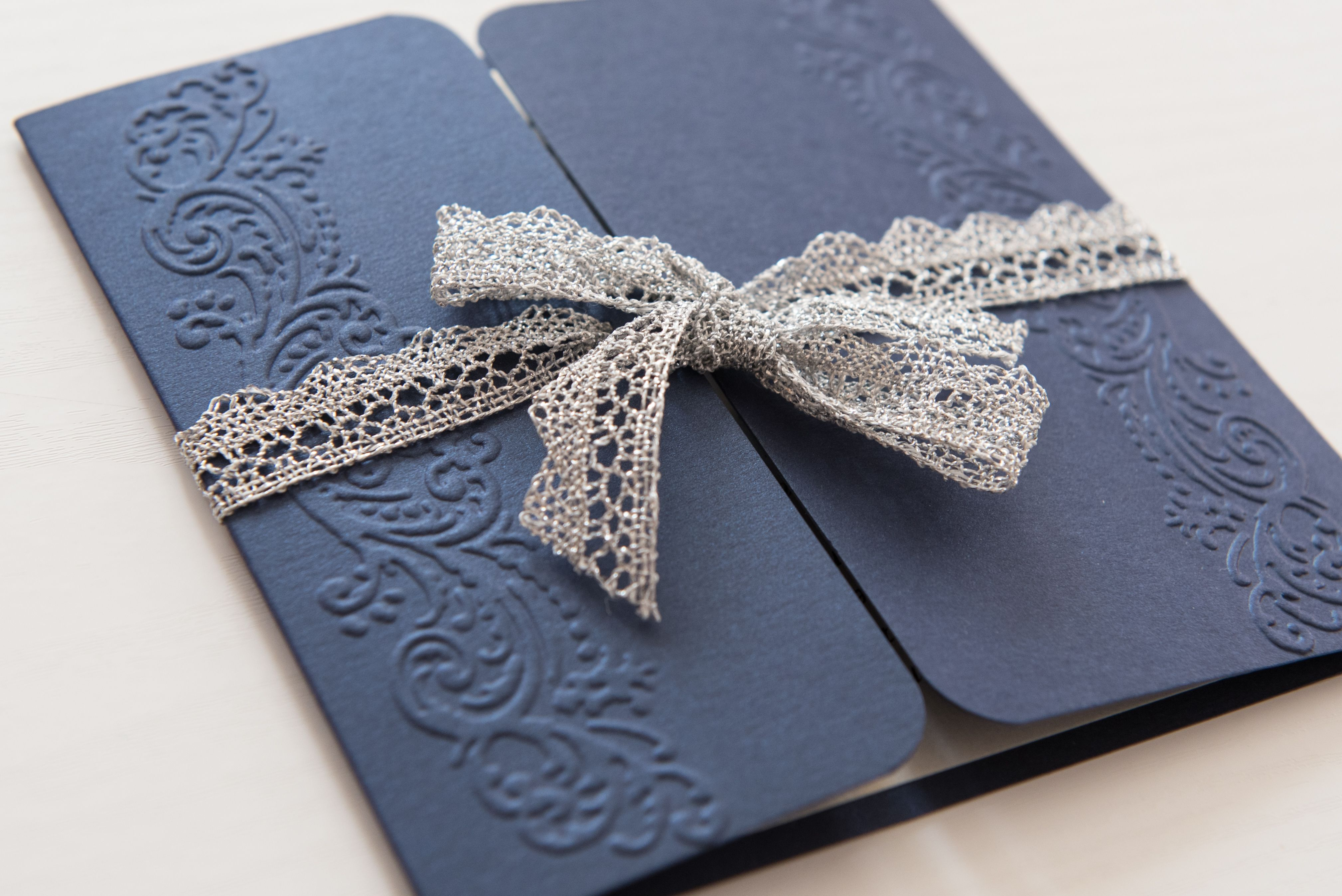 Navy blue winter wedding invitation with lace detail winter