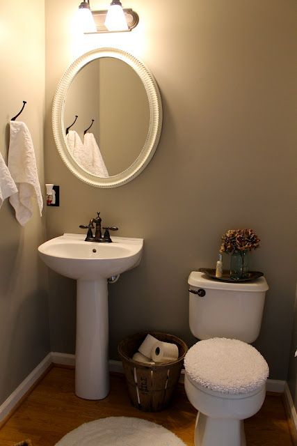 love this idea for extra toilet paper rolls in powder room with pedestal sink grey