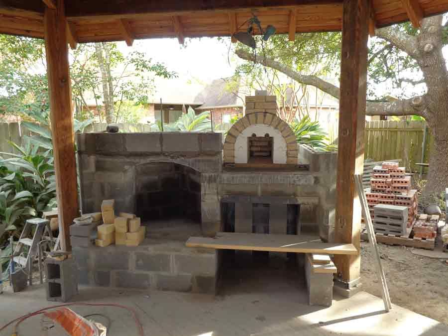 the hammer family wood fired pizza oven and fireplace combo in