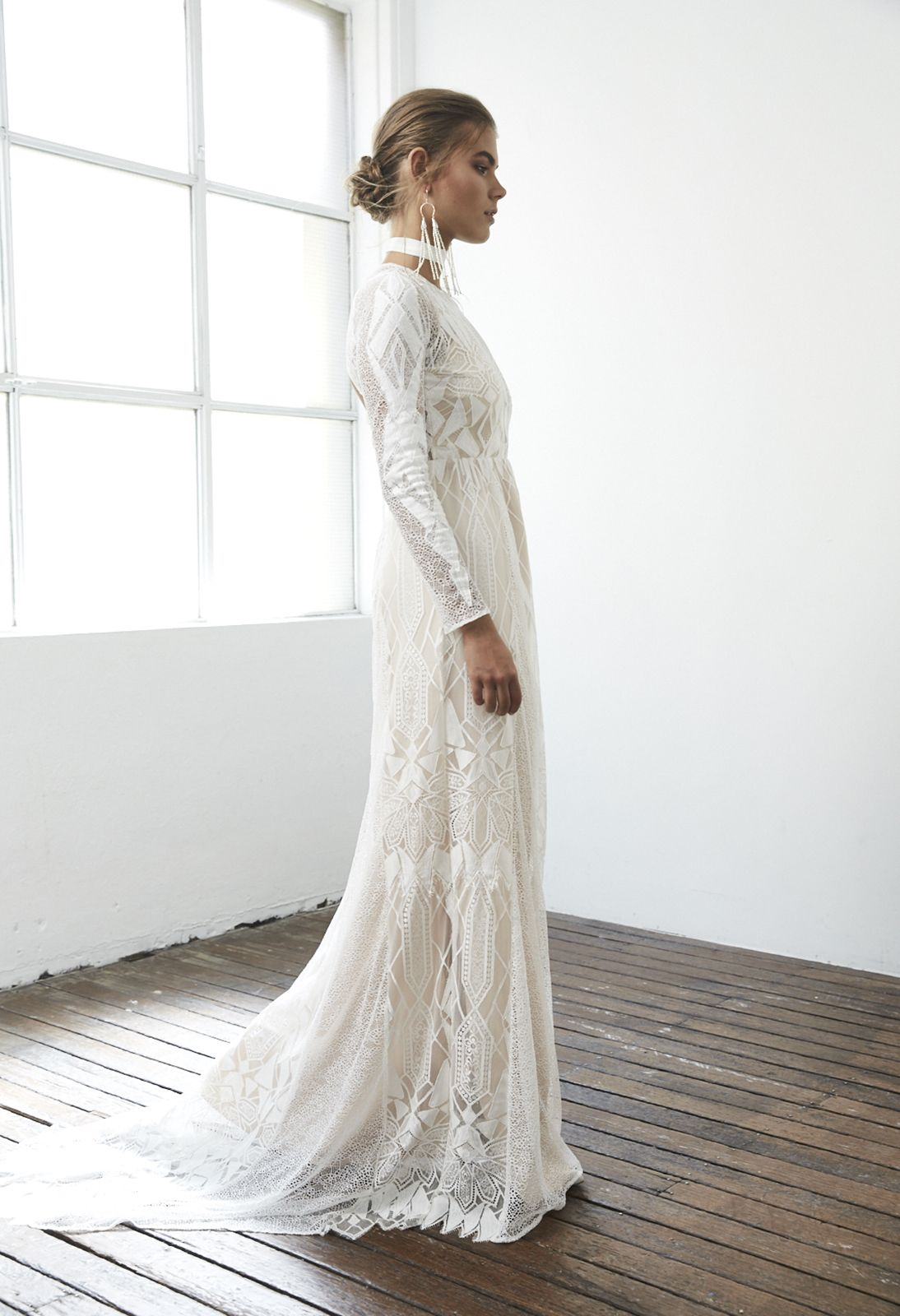 Designed for the ethereal elegant beauty, the Soho gown from our Blanc Collection fuses a contemporary silhouette with soft, yet bold details.