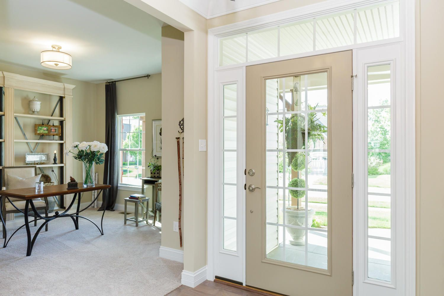 A Full Glass Entry Door Is Surrounded By Sidelights And A Glass