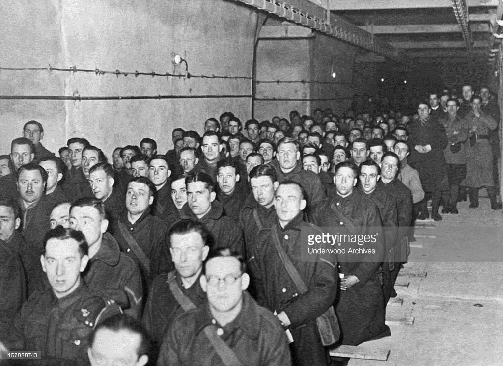 French and British soldiers assigned to duty in the Maginot Line attend Holy Mass, France, March 27, 1940.