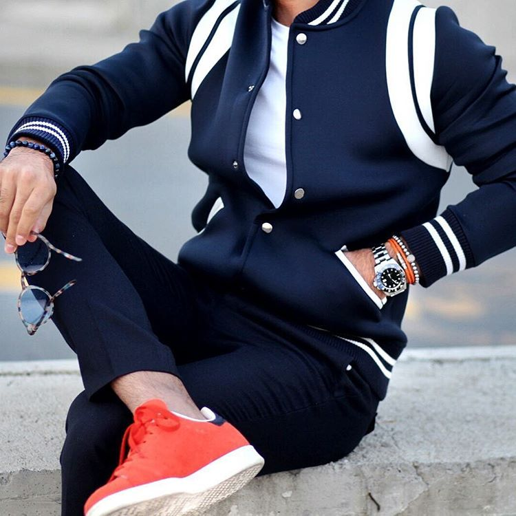 varsity jacket and dark denim