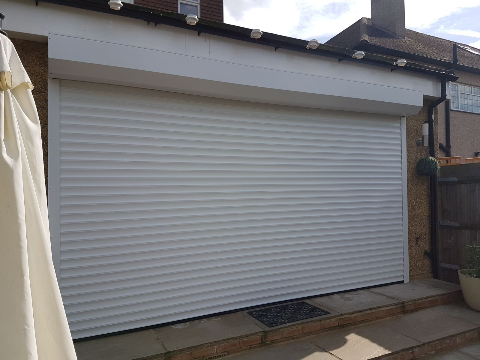 An Outside View Of Our Rsg5100 Domestic Roller Shutter Fitted On A Large French Door Of His Residence In South Londo Roller Shutters Shutters Security Shutters