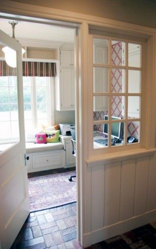 Love using an old entry door instead of the standard french doors for an office.