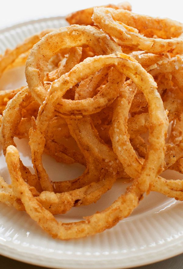 Thin enough to flash-fry but thick enough to let the sweet onion flavor shine through, these onion rings work well as a side dish but also are great as a stand-alone snack. (Photo: Amber Fouts for The New York Times) #onionringsrecipe