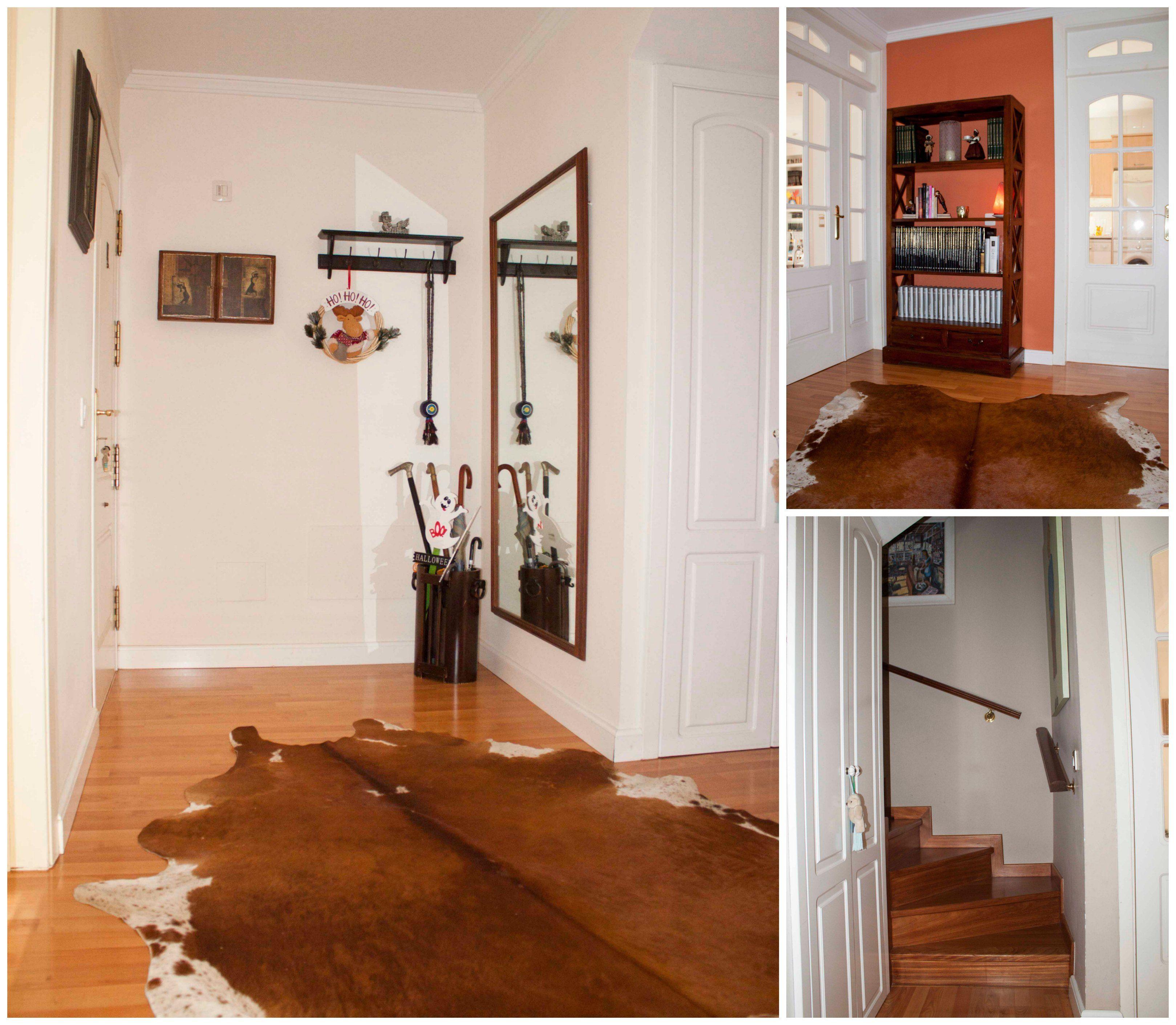 Entrada principal a la vivienda que distribuye el acceso a la planta alta, salón y cocina con un aseo.
