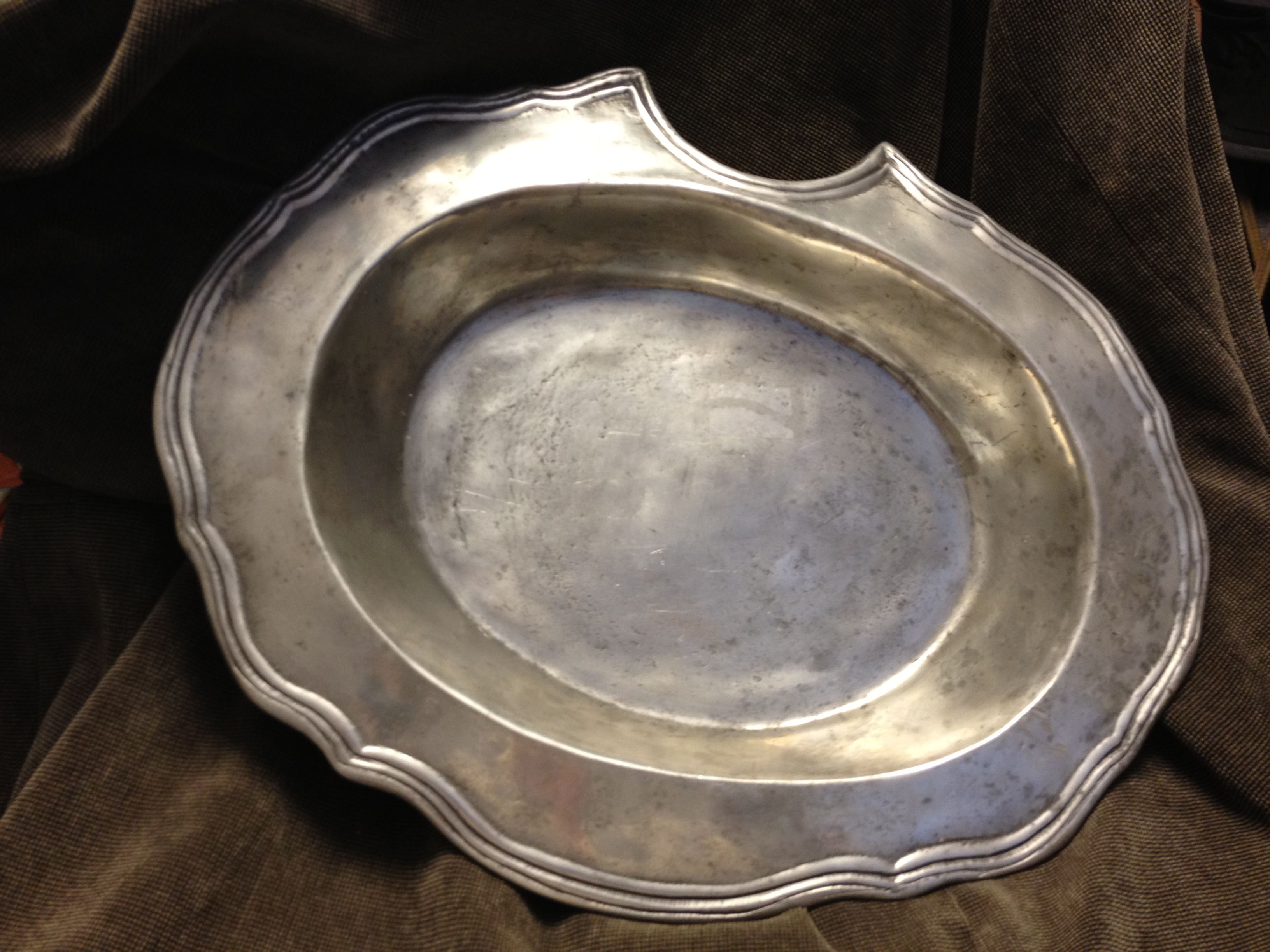 To ensure a nice clean shave, 18th century barbershops throughout England and France would have used this type oval pewter basin (with section cut out on brim) on all of their preferred customers.