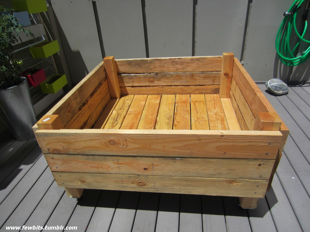 Easy raised garden bed on casters for patio or deck - What to put under raised garden beds ...