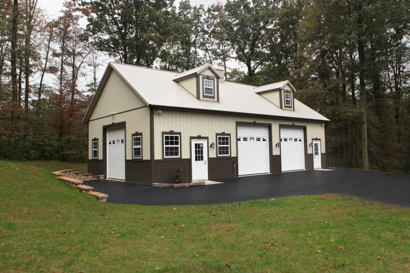 3 Car Garage Clay Roof Lightstone Sides Bronze Trim And