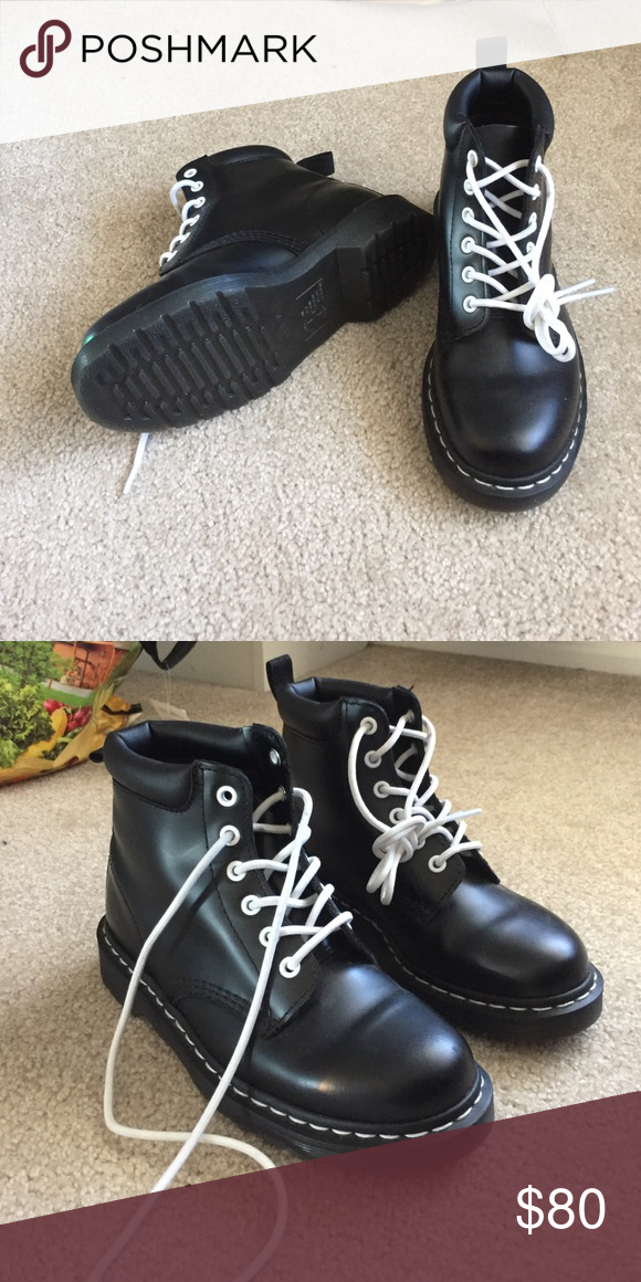 981139315a4 Dr Martens boots Black 6 eye Doc Martens. White stitching. Never worn.  Really cute but they just don't fit. Size US 7 womens / US 6 men.