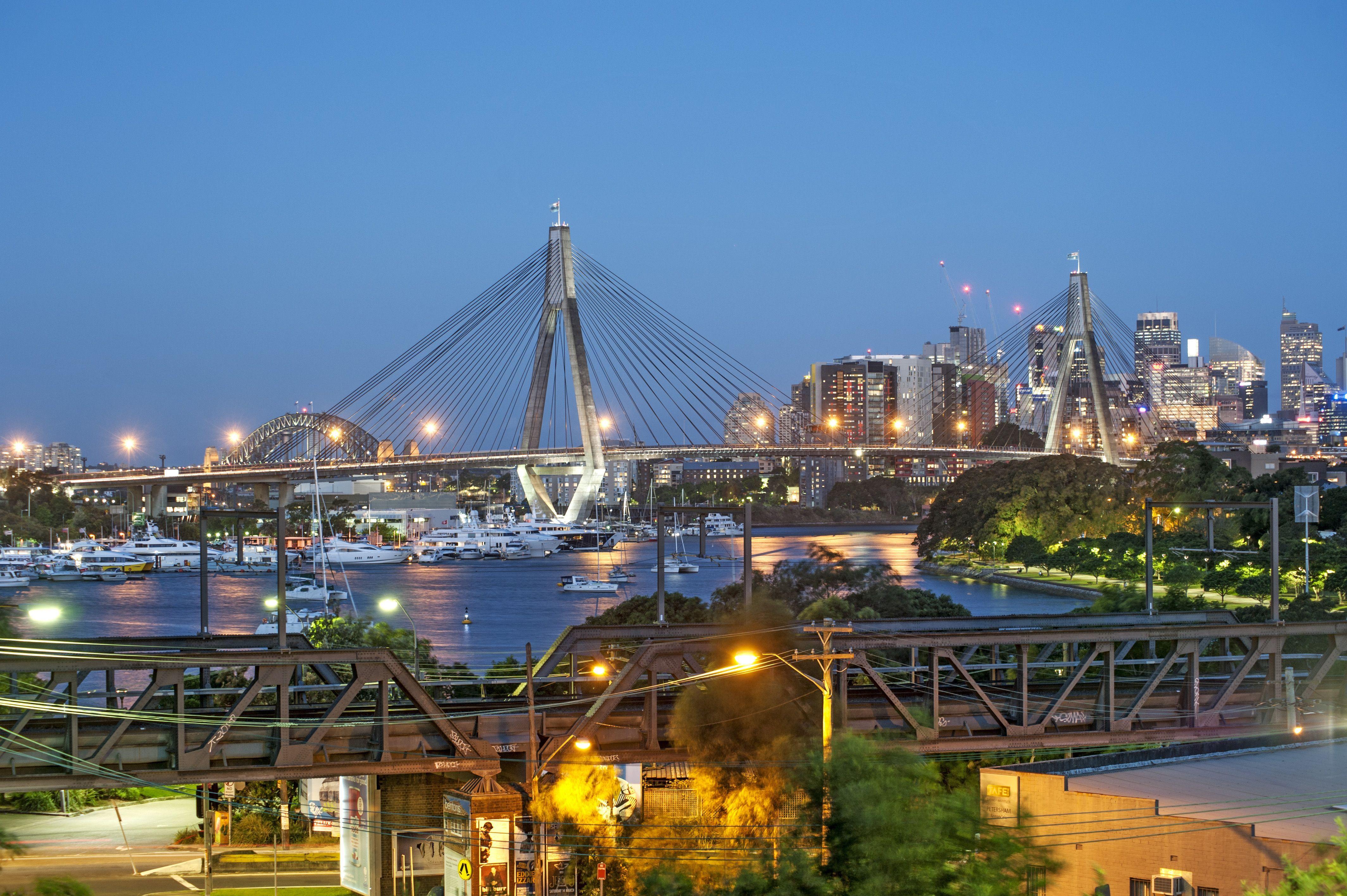 This view of the Anzac Bridge, Sydney Harbour Bridge and the city ...