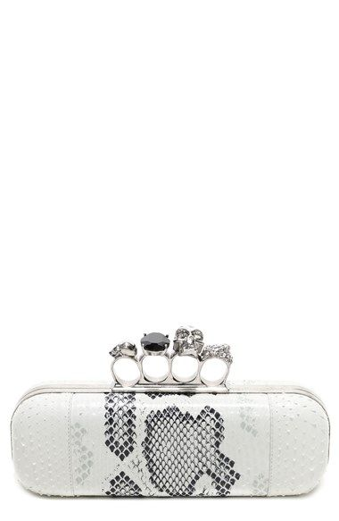Alexander McQueen offers this genuine python clutch as part of its nature-nuanced fall collection. A silvertone knuckle clasp crowned with goth motifs and sparkling ...