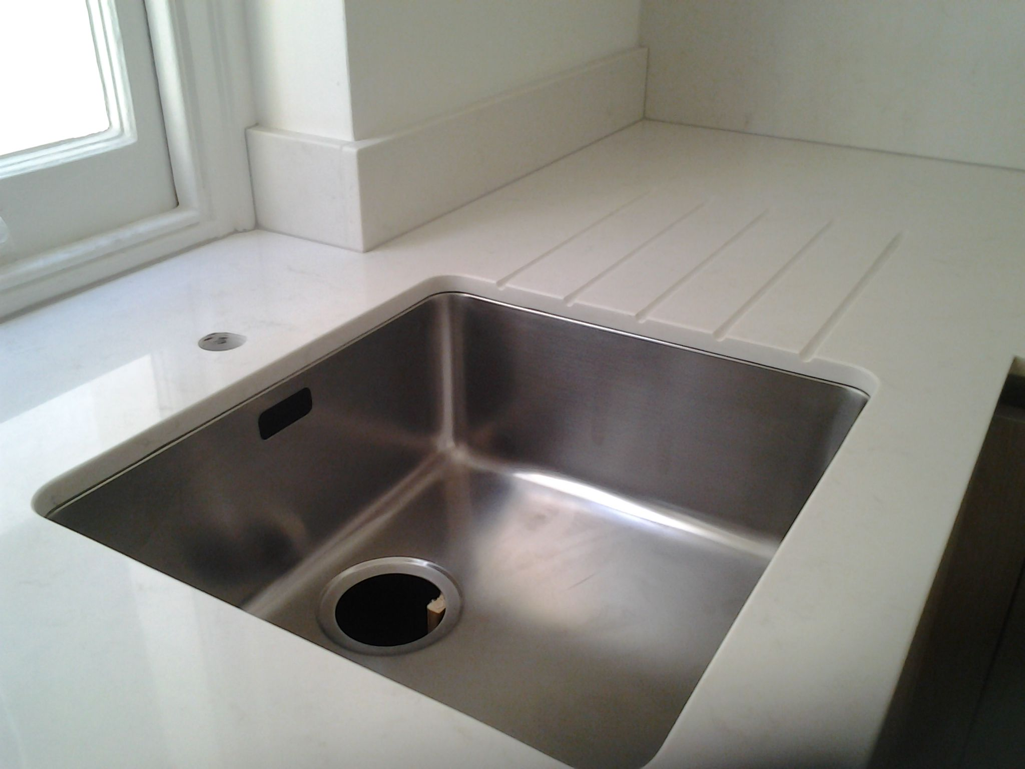 pac Carrara Quartz worktops with an undermount sink