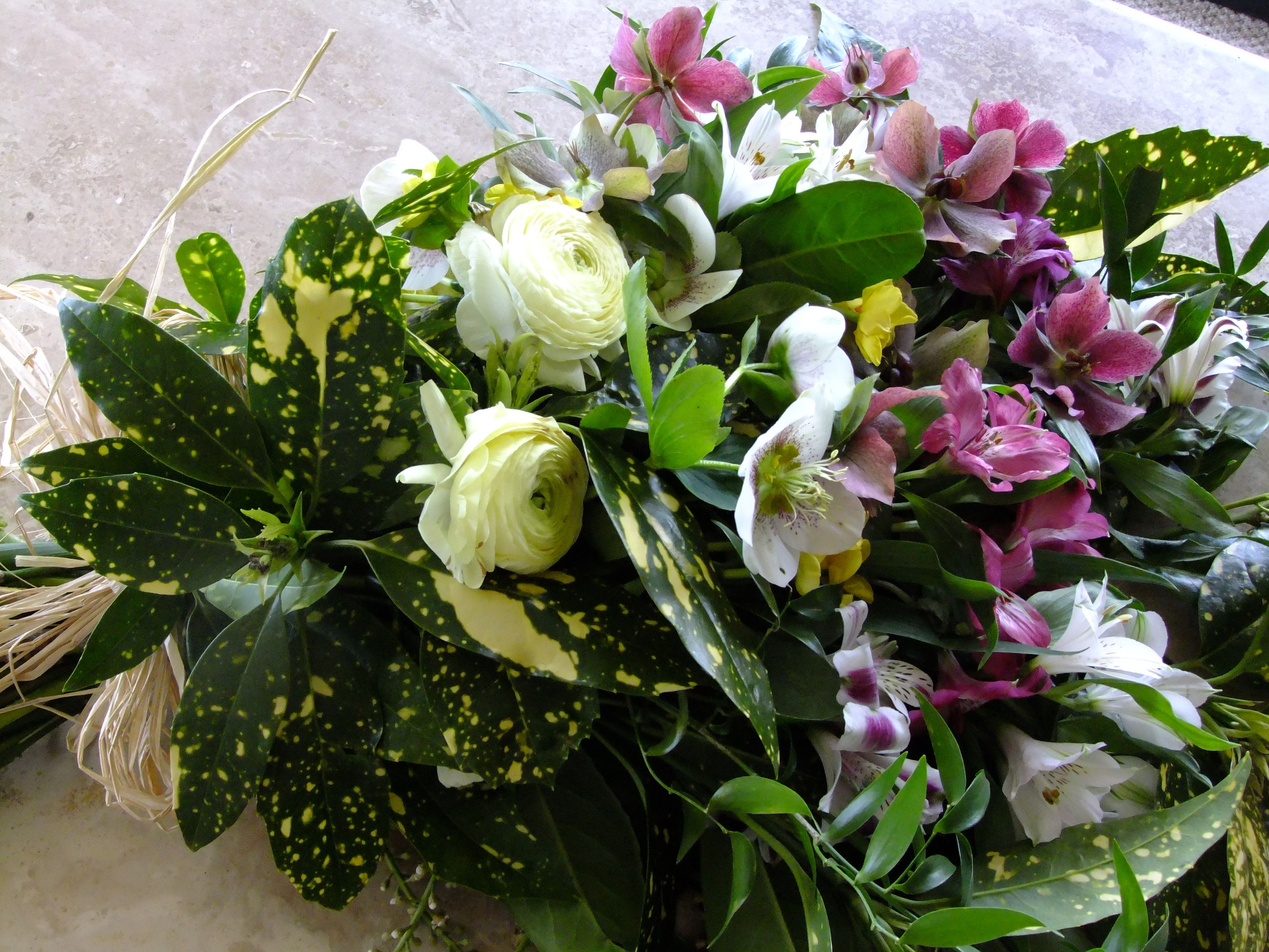 A Funeral Sheaf Of Spring Flowers In Purple And White Including