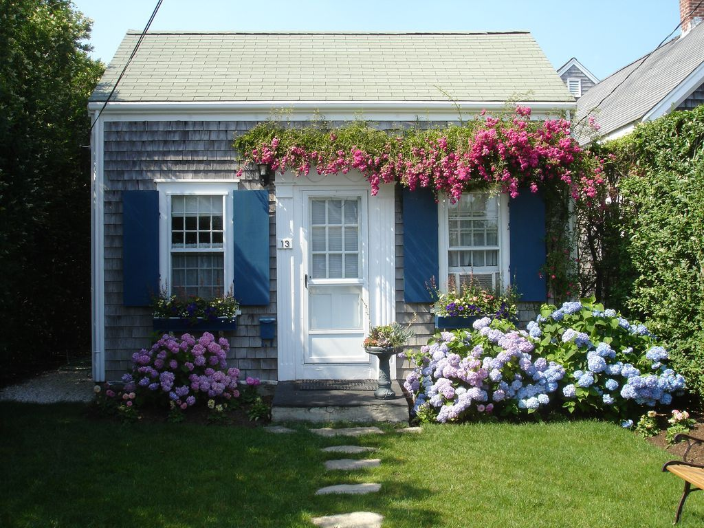 This charming two story classic Nantucket rose covered