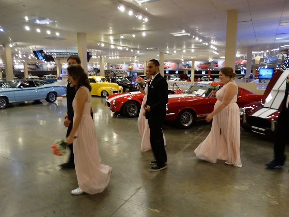 A Beautiful wedding venue surrounded by beautiful classic cars ...