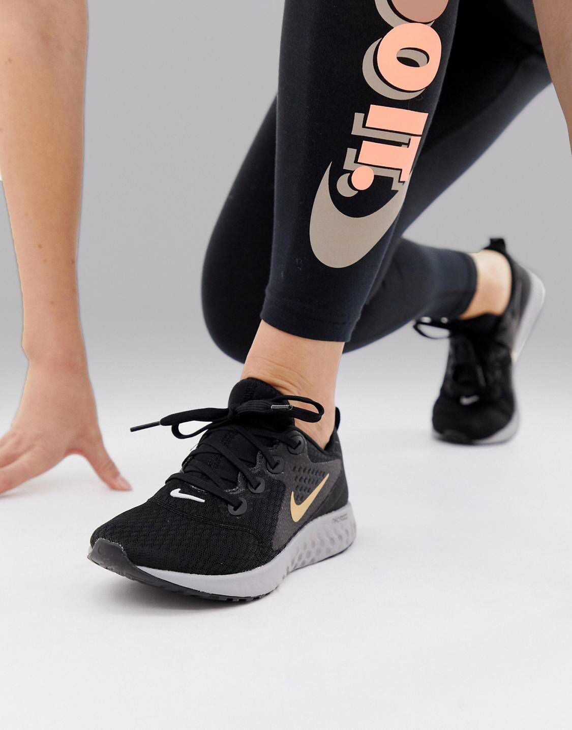buy popular 436b8 4d3a7 Nike Running Legend React Trainers In Black And Gold | Iphone ...