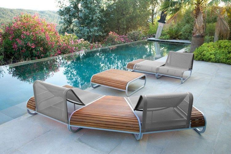 canapé design en bois et métal, table basse assortie et piscine à ...