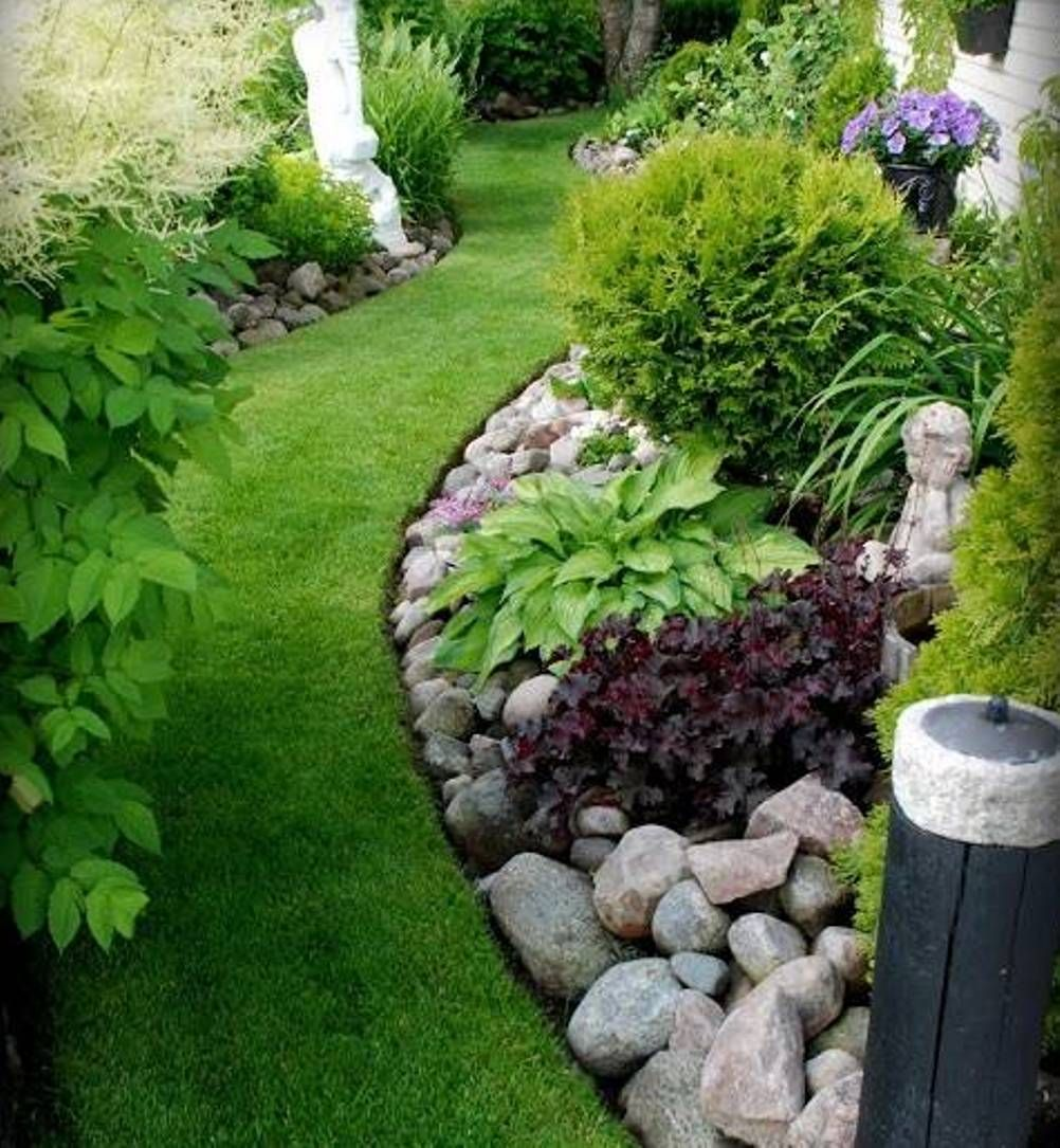 Clean of lawn rock garden ideas with green grass as Landscaping with rocks
