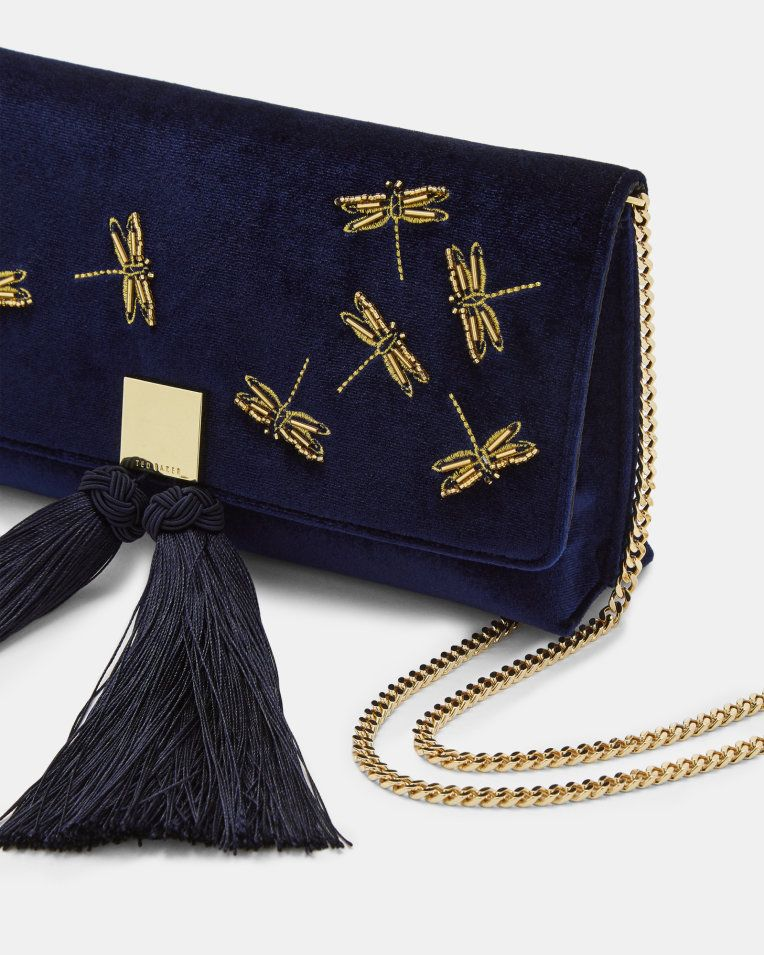 88d739e98d Add some glitter to your evening glamour with Ted's KASIA clutch. This  opulent velvet design features a sophisticated gold shoulder strap and  tassel ...