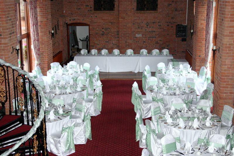 Mint green taffeta sashes on white swirl chair covers