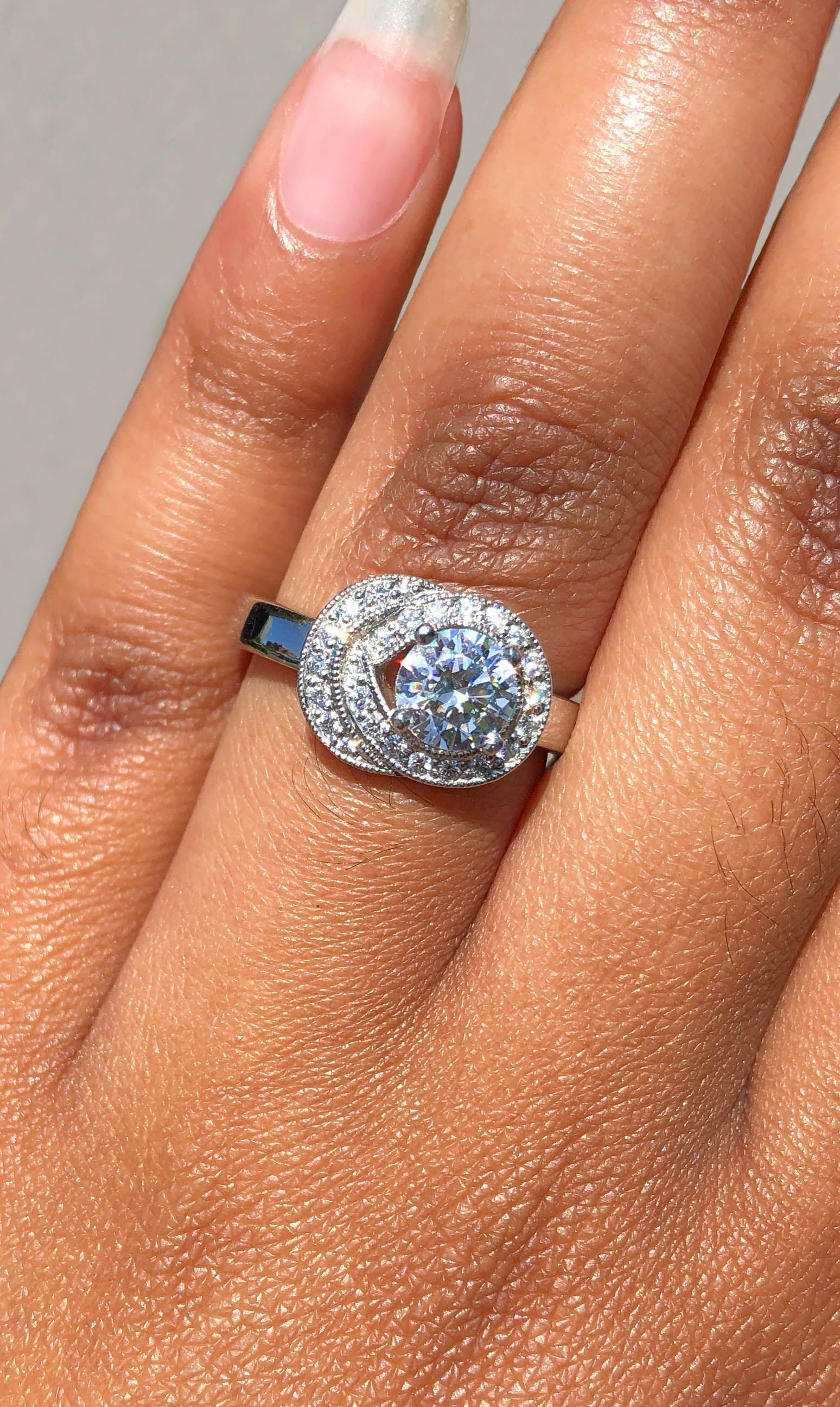 Platinum Braided Halo Round Diamond Engagement Ring. Green