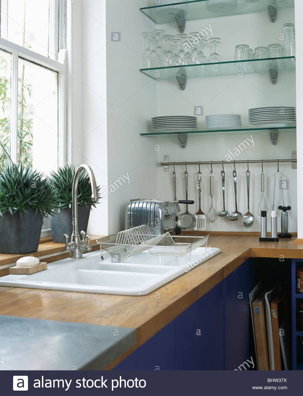 Trending The New Open Shelving The Identite Collective Glass Kitchen Cabinets Marble Countertops Kitchen Framed Kitchen Cabinets