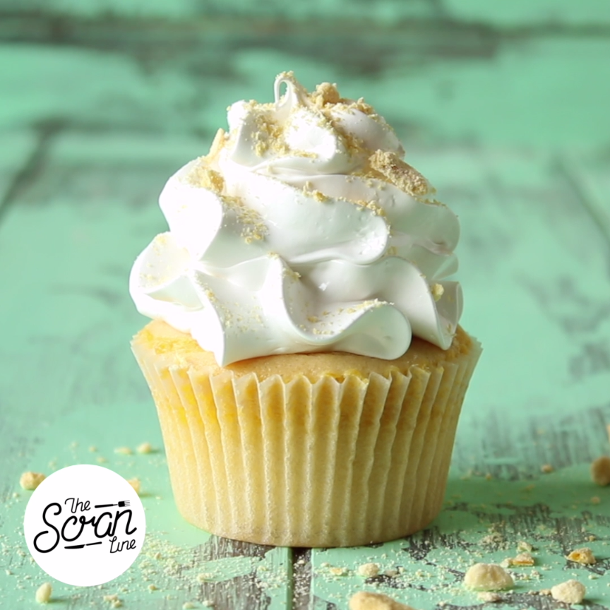 A mango curdfilled vanilla cupcake topped with a swirl of meringue frosting is the stuff of sweet dreams