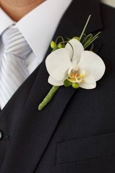 Boutonniere: Silk white orchid, fresh green hypericum berries, fresh bear grass.