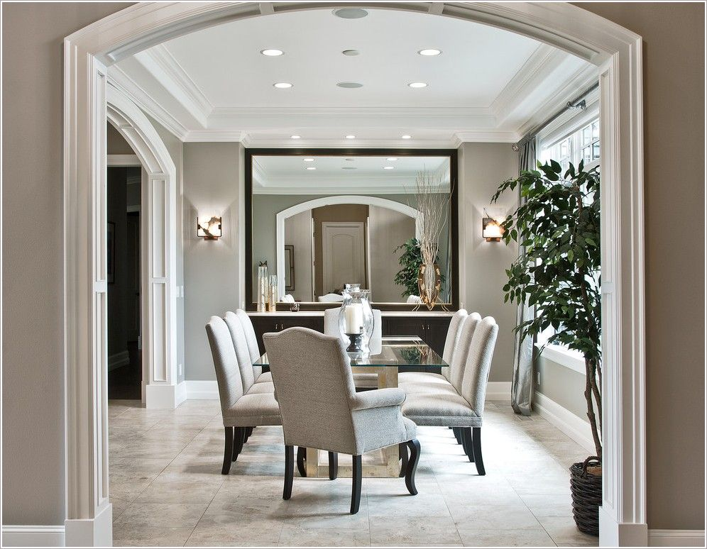 Dining Room Transitional Seattle Arch Doorway Arched Entry Beige Chair Molding Trim Beveled Mirror Candle Hurricane Crown Moulding
