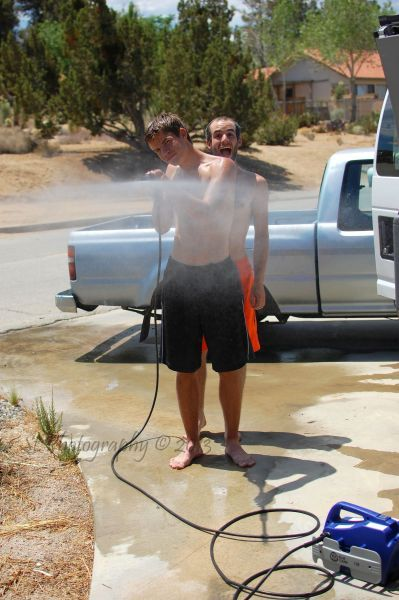 """May 12th, 2013:  Perfection on Mother's Day.  When """"family cleaning their fleet of vehicles"""" day turns into """"playing with the pressure washer and photo bombing your brother's picture"""" day."""