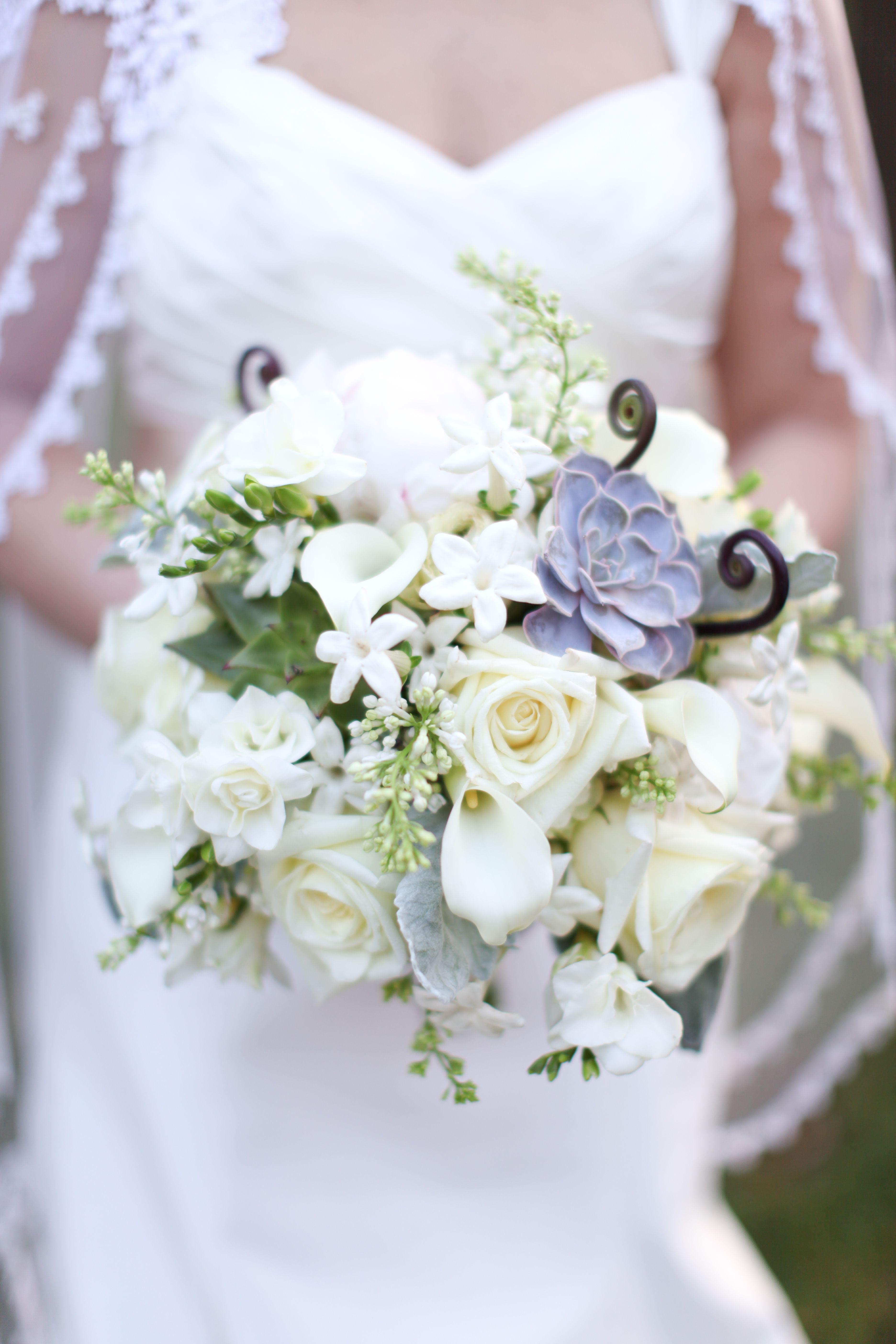 Organic bouquet of brown fern curls , peonies , garden roses ...