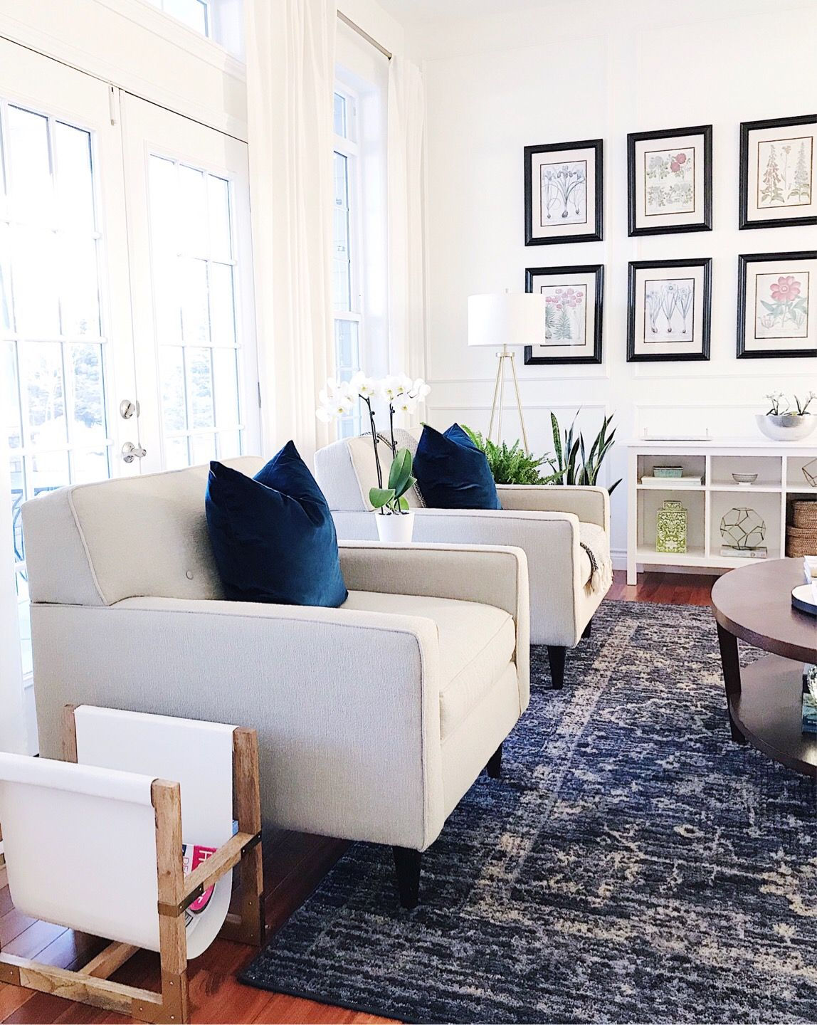 Blue and white living room with botanical gallery wall http://rstyle ...