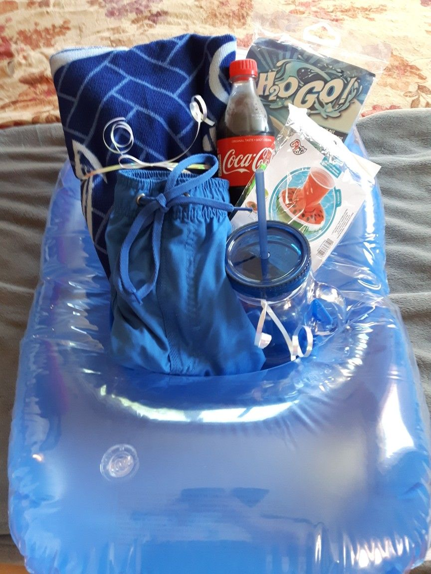 Pool party/swim Theme Gift Basket for a male.  Swimming pool