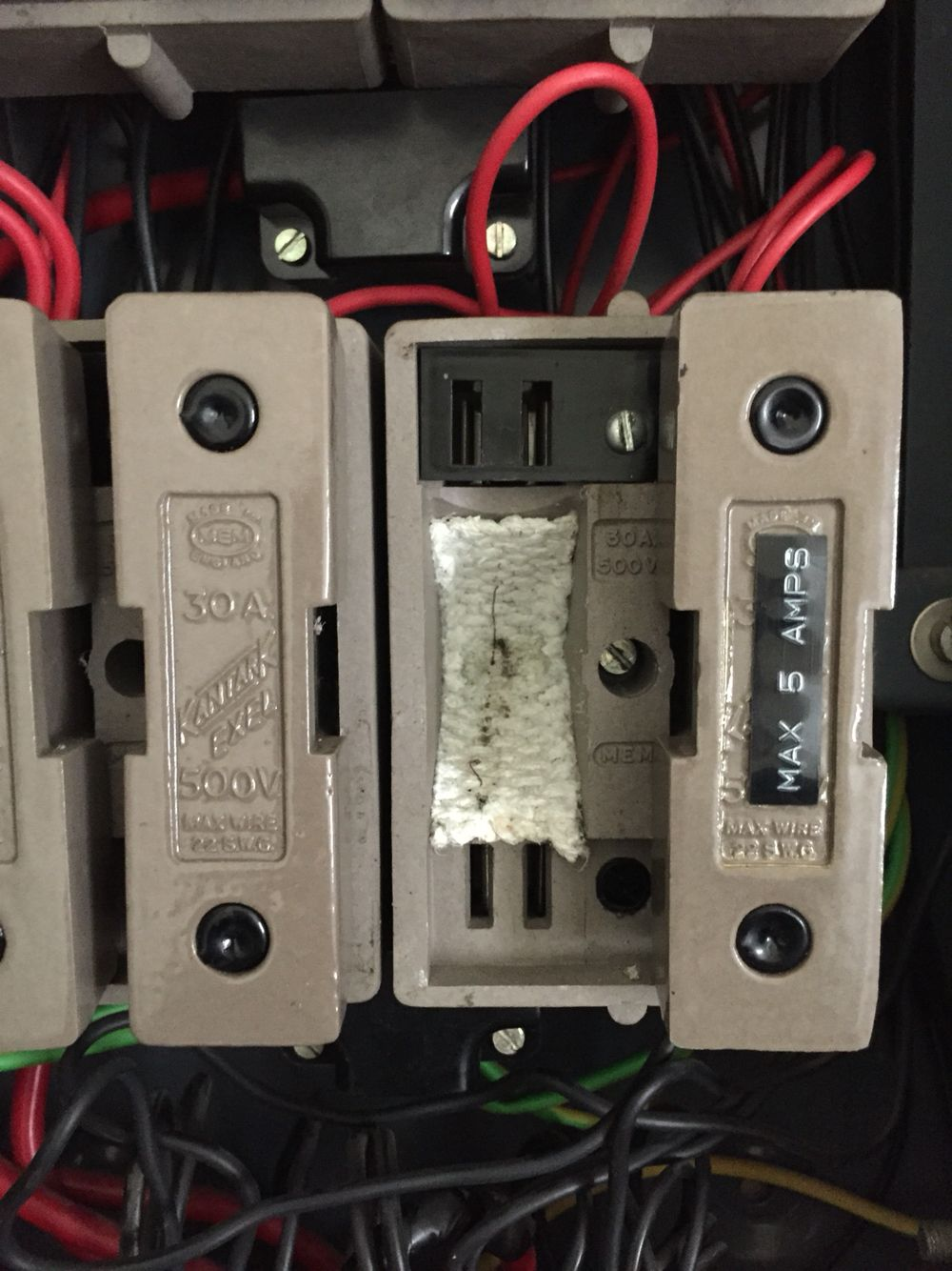 Asbestos fuse lining in old style 3 phase fuse board | Dodgy finds ...
