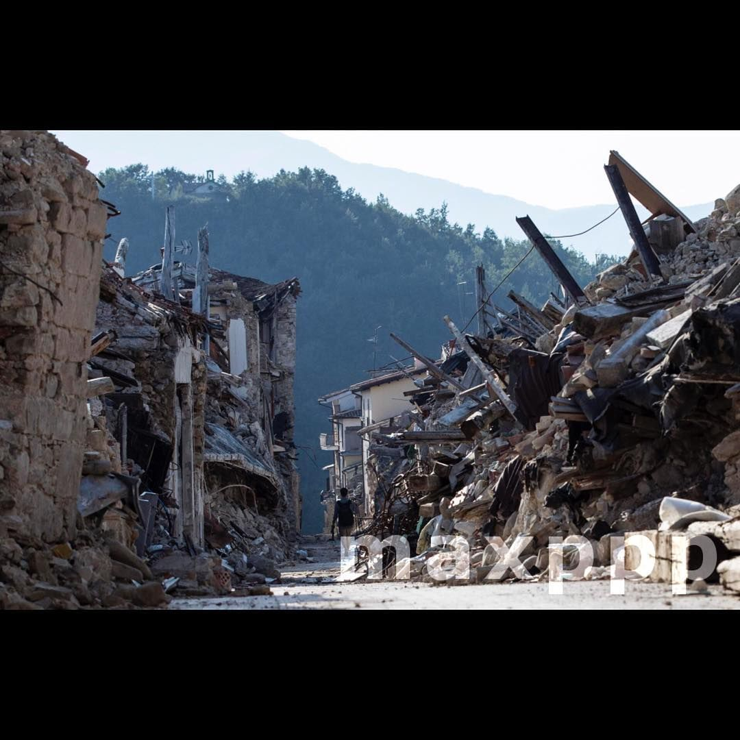 A Man Walks Between The Rubble In Amatrice Italy On 01 August