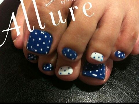 pretty pedicure blue polish with white polka dots and