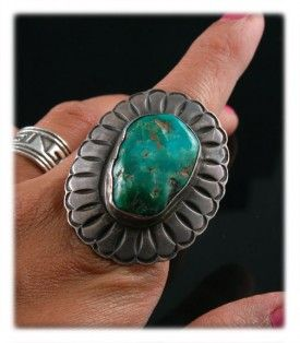 Vintage Mineral Park Turquoise that has been loved.  This stone most likely was a mid to light blue when first set.  It has been loved over the years and the oils from the skin, lotions, sunscreen, etc. have turned one side of the ring a beautiful emerald green. I actually prefer it this way.