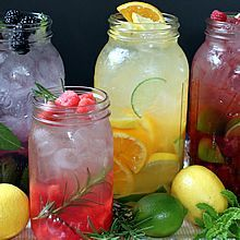 """Naturally Flavored Water -- An easy formula for making an endless variety of fruit and herb infused waters. Say goodbye to soda, juice, and bottled water with these refreshing, healthy """"spa water"""" flavors!"""