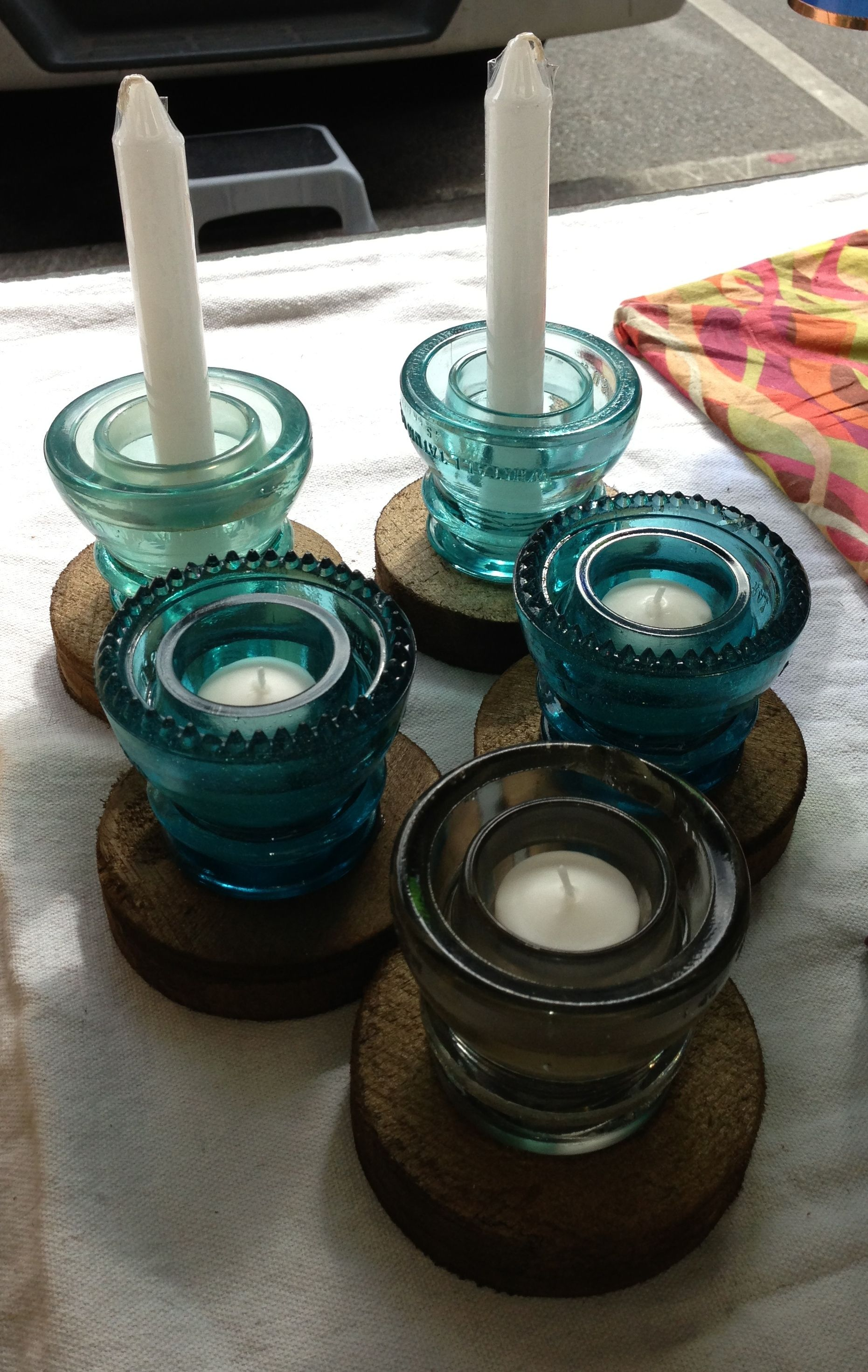 Assorted candle holders made from upcycled glass insulators. www.giveupcycled.com