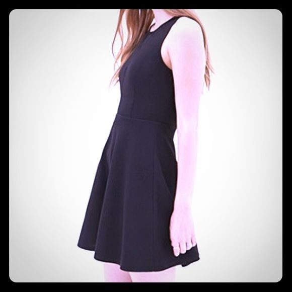 Short black f21 dress Cute, cotton. Too short for me! I wore it once as a swim cover up. Forever 21 Dresses