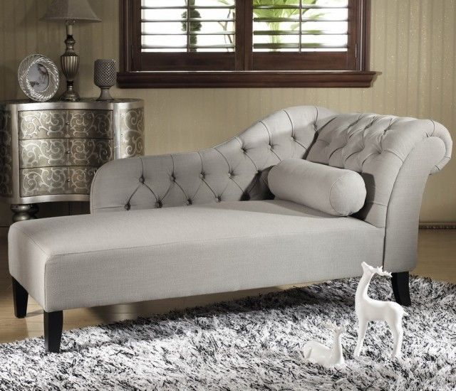 soft grey modern chaise lounge with tufted style back with black