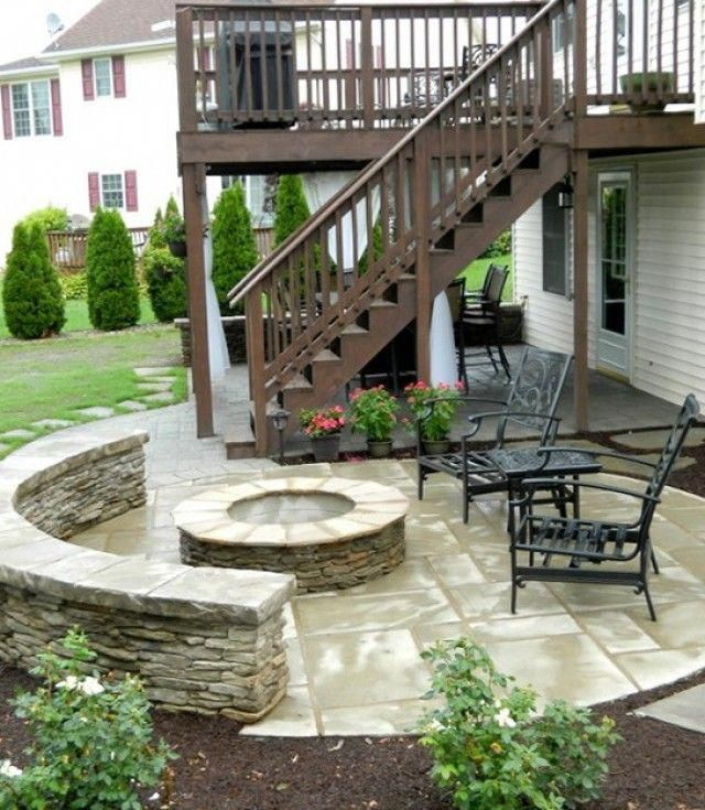 fire pit area by the stairs a swing seating area under on steps in discovering the right covered deck ideas id=90027