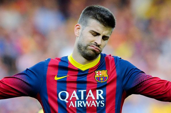 Gerard Pique of FC Barcelona reacts dejected during the La Liga match between FC Barcelona and Club Atletico de Madrid at Camp Nou on May 17, 2014 in Barcelona, Catalonia. Atletico de Madrid won the Spanish league La Liga.