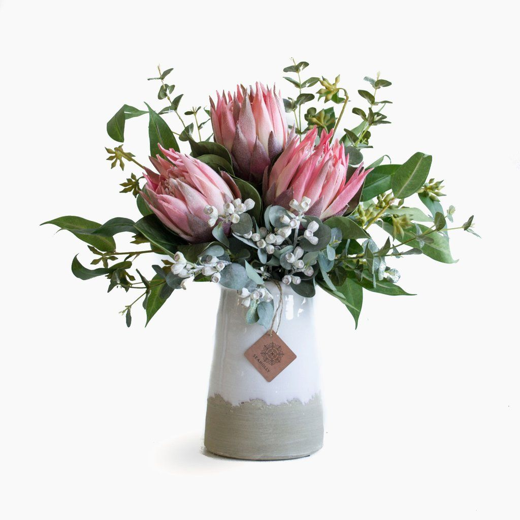 Pink Protea Eucalyptus And Tetra Nuts In Milk Vase Australian Native Flowers Fake Flower Arrangements Artificial Flowers Wedding