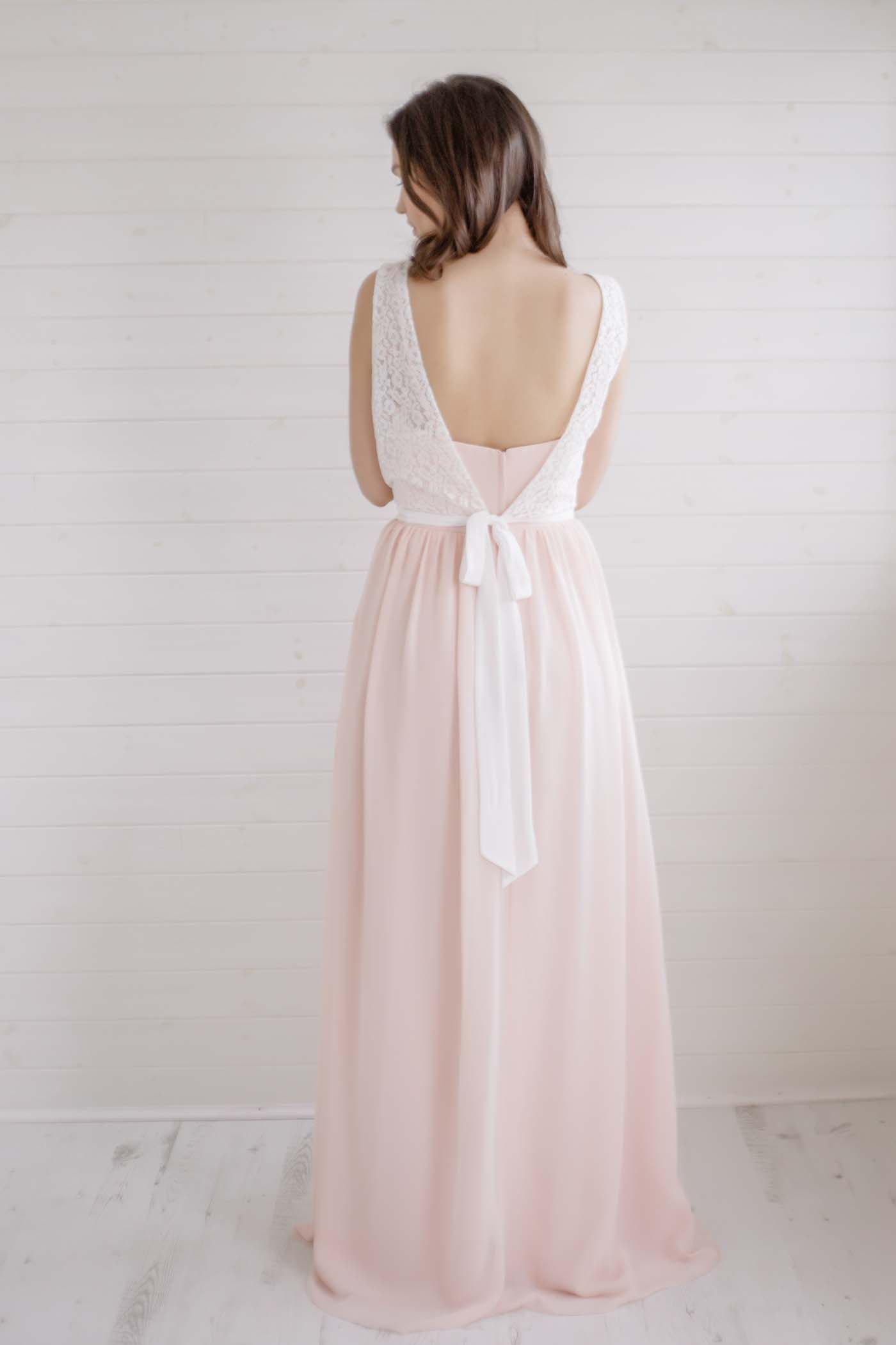 Stunning pale pink bridesmaids dress with lace jacket pale pink